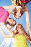 Young people across blue sky Royalty Free Stock Photography