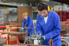 Free Young People At Work In Factory Stock Image - 119527781