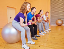 Young people in back training class. In a fitnesscenter with dumbbells Royalty Free Stock Images