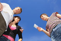 Young people on a background sky. Royalty Free Stock Image