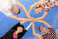 Young people on a background sky. Stock Photography