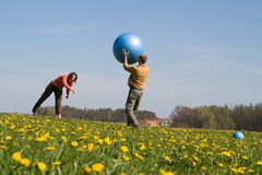 Young people with ball Royalty Free Stock Photo