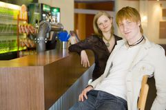 Young people at the bar Royalty Free Stock Images