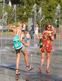 Young people bathing in dry fountain Royalty Free Stock Photography