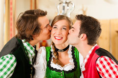 Young people in Bavarian Tracht in restaurant Royalty Free Stock Photo