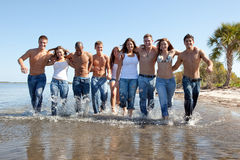 Young people at the beach stock photos