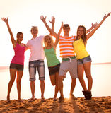 Young people at the beach Stock Images