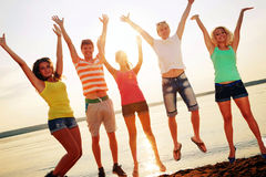 Young people at the beach Royalty Free Stock Images