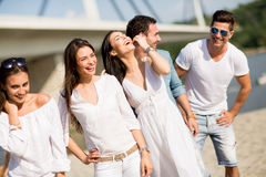 Young people on the beach Stock Photography