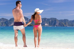 Young People On Beach Summer Vacation, Couple Walking Seaside Blue Water. Sea Ocean Holiday Travel Stock Image