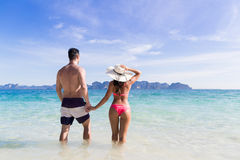Young People On Beach Summer Vacation, Couple Walking Seaside Blue Water Stock Image