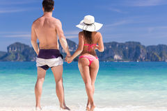 Young People On Beach Summer Vacation, Couple Walking Seaside Blue Water. Sea Ocean Holiday Travel Stock Images