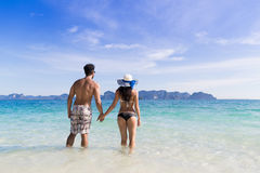Young People On Beach Summer Vacation, Couple Walking Seaside Blue Water Royalty Free Stock Photos