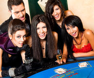 Young people behind black jack table Stock Photography