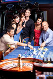 Young people betting roulette table Stock Image