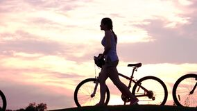 Young people with bicycles at sunset. stock video