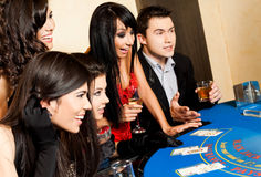 Young people black jack casino Stock Photography