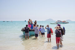 Young people board a little vietnamese boat Royalty Free Stock Photo