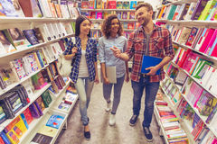 Young people at the book shop Royalty Free Stock Image