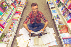 Young people at the book shop royalty free stock photo