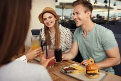 Young people with burgers stock photography