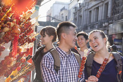 Young people buying candied haw. Royalty Free Stock Image