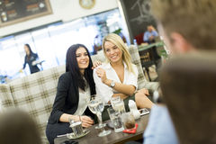 Young people in cafe Stock Images