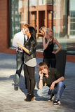 Young people calling on the cell phones. Young men and women calling on the cell phones Royalty Free Stock Image