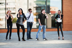Young people calling on the cell phones Royalty Free Stock Photography