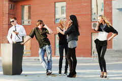 Young people calling on the phones Royalty Free Stock Images