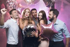 Young people came to the club to dance. They are very fun. They are dressed in costumes. Royalty Free Stock Image