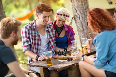 Young people at camp plays chess Royalty Free Stock Images