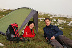 Young people camping in the mountains. Two young people camping in the mountains alps Royalty Free Stock Photography