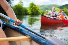 Young People Canoeing. On the neckar river in germany royalty free stock photos