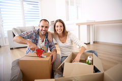Young people with cardboxes moving in stock image