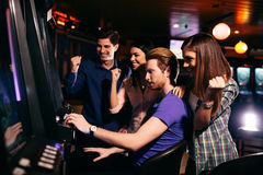 Young people in the casino Stock Photo