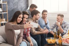Young people in casual clothes are resting at home Royalty Free Stock Images