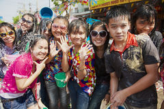 Young people celebrate traditional Songkran festival at the street. KHON KAEN, THAILAND - APRIL 13, 2010: Unidentified young people celebrate traditional Stock Images