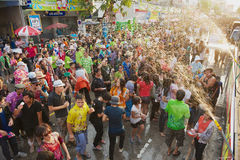Young people celebrate traditional Songkran festival at the street. Stock Photo