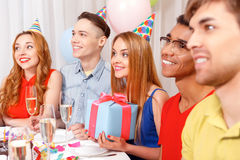 Young people celebrating a birthday sitting at the Stock Image