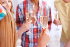 Young people celebrating with champagne Stock Photos