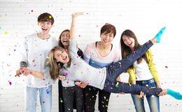 People celebrating holiday and party at home. Young people celebrating holiday and party at home stock image