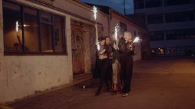 Young people celebrating new years eve with sparklers stock footage