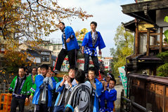 Young people celebrating a sake festival in the old town of Hida Takayama, Japan royalty free stock photos
