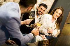 Young people celebrating and toasting with white wine Royalty Free Stock Photo