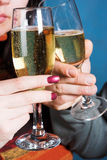 Young people with champagne glasses Stock Photos