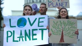 Young people chanting slogans about planet ecology, deforestation problems