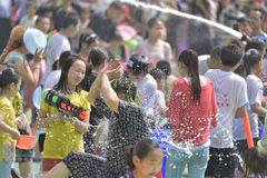 Young people and children in a water fight Royalty Free Stock Photography