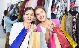Young people choosing clothes Stock Image
