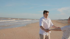 Young people circling holding hands stock footage